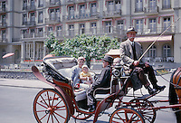 Family enjoying a Carriage Ride in France. 1959.