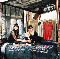 Daisy, Betty and Pearl Lowe in the boudoir of their Hampshire country house