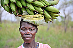 A woman carries bananas to market in Nyei, a village in SOuthern Sudan where people have returned after years in exile to rebuild their land after a devastating civil war.