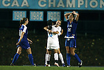 24 September 2009: North Carolina's Alyssa Rich (behind, in white) celebrates scoring the game winning goal with Ranee Premji (CAN) (30) as Duke's Elisabeth Redmond (16) and Nicole Lipp (10) react differently. The University of North Carolina Tar Heels defeated the Duke University Blue Devils 2-1 in sudden victory overtime at Fetzer Field in Chapel Hill, North Carolina in an NCAA Division I Women's college soccer game.