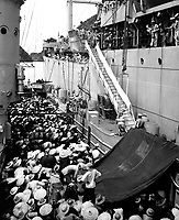 Vietnam refugees.  USS Montague lowers a ladder over the side to French LSM to take refugees aboard.  Haiphong, August 1954.  PH1 H.S. Hemphill.  (Navy)<br /> EXACT DATE SHOT UNKNOWN<br /> NARA FILE #:  080-G-644449<br /> WAR &amp; CONFLICT BOOK #:  386