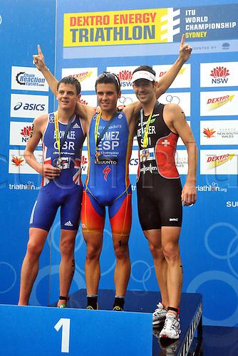 10.04.2011 Dextro Energy Triathlon from Sydney Australia. Javier Gomez (ESP), Jonathan Brownlee (GBR) and Sven Riederer (SUI) stand on the Podium