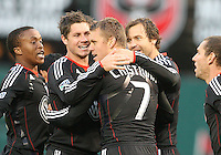Adam Cristman #7 of D.C. United is surrounded by teammates Boyzzz Khumalo #17, Devon McTavish #18, Carey Talley #8 and Kurt Morsink #6 after scoring his first of two goals during a US Open Cup match against F.C. Dallas on April 28 2010, at RFK Stadium in Washington D.C. United won 4-2.