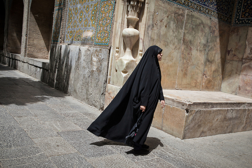 A hijab-wearing Iranian woman in Isfahan. Iran has a harsh punishment against women going into public without wearing their hijab. Article 102 of Iran's constitution dictates that ?women who appear on streets without the 'Islamic hijab' will be condemned to 74 strokes of the lash.? However, in many big cities across the country, many Iranian women do not really concern about wearing hijab as the government rules stated.