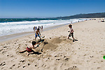 Boys playing on the beach at Half Moon Bay Beach, .San Mateo Coast of California, south of San Francisco.  Photo copyright Lee Foster, 510-549-2202, lee@fostertravel.com, www.fostertravel.com. Photo 440-30808