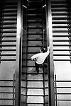 A man on an escalator