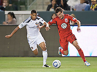CARSON, CA – June 3, 2011: LA Galaxy defender Sean Franklin (5) and DC United midfielder Chris Pontius (13) fight for the ball during the match between LA Galaxy and DC United at the Home Depot Center in Carson, California. Final score LA Galaxy 0, DC United 0.