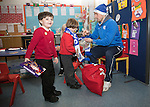 St Johnstone players took some festive cheer to Fairview School in Perth gving out selection boxes and gifts to the pupils&hellip;David Wotherspoon wraps a Saints scarf around primary school pupil Jack watched by fellow pupil Logan<br />Picture by Graeme Hart.<br />Copyright Perthshire Picture Agency<br />Tel: 01738 623350  Mobile: 07990 594431
