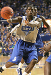 DeAndre Liggins passes the ball during the first period of the Blue and White scrimmage at Rupp Arena Wednesday night..Photo by Zach Brake | Staff