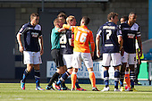 The match official intervenes as events become a little heated - Millwall vs Blackpool - NPower Championship Football at the New Den, London - 18/08/12 - MANDATORY CREDIT: Ray Lawrence/TGSPHOTO - Self billing applies where appropriate - 0845 094 6026 - contact@tgsphoto.co.uk - NO UNPAID USE.
