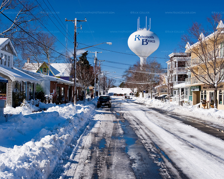 The landmark Rehoboth Beach water tower stands above snowy streets and buildings the morning after the blizzard of February 2010.  (Rehoboth Beach, Delaware, USA).