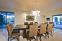 large modern rectangular table permits the seating of 10 in elegant diing room