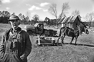 Fourche Valley, AR. December, 1980. <br /> Roc Mc Tigert (80 years old). Due to the gassoline being so expensive, he cannot use his truck anymore, so he uses his horse to carry the loads in his farm.