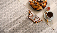Francois, a waterjet mosaic shown in honed Carrara, Dolomite, and Paperwhite, is part of the Illusions™ Collection by Sara Baldwin Designs for New Ravenna.