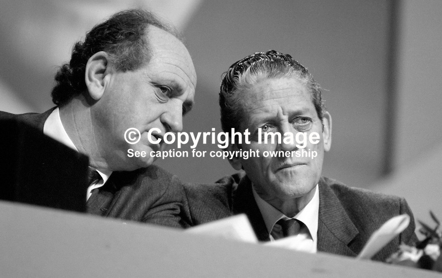 Gerry Collins, TD, Minister for Justice, left, talking with Brian Lenihan, TD, Minister for Foreign Affairs, on platform at Fianna Fail Ard Fheis, 19880203GC+BL..Copyright Image from Victor Patterson, 54 Dorchester Park, Belfast, UK, BT9 6RJ..Tel: +44 28 9066 1296.Mob: +44 7802 353836.Voicemail +44 20 8816 7153.Skype: victorpattersonbelfast.Email: victorpatterson@me.com.Email: victorpatterson@ireland.com (back-up)..IMPORTANT: If you wish to use this image or any other of my images please go to www.victorpatterson.com and click on the Terms & Conditions. Then contact me by email or phone with the reference number(s) of the image(s) concerned.
