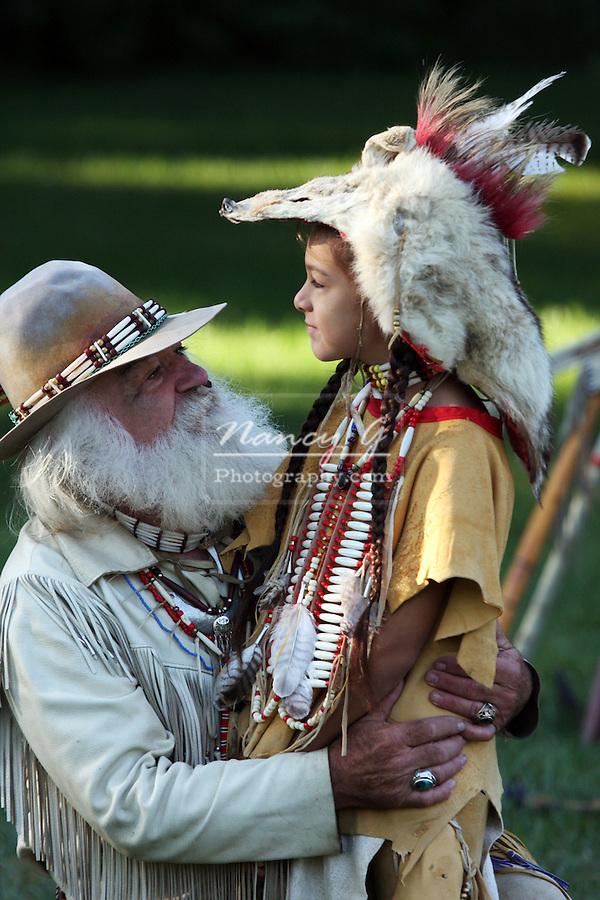 young Native American Indian boy talking mountainman buckskinner