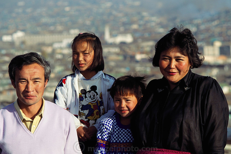 Portrait of the Batsuuri family of Ulaanbaatar, Mongolia. The Regzen Batsuuri family lives in a 200 square foot ger (round tent built from canvas, strong poles, and wool felt) on a hillside lot overlooking one of the sprawling valleys that make up Ulaanbaatar, Mongolia. Material World Project.