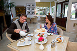 Man, Woman, Taking, Afternoon Tea, Cakes, Scones, Tea, Pastries, Royal Hotel, Ventnor, Isle of Wight, England, UK, Photographs of the Isle of Wight by photographer Patrick Eden