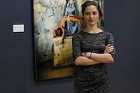 """Stamford, CT. 11 October 2014. The Colombian Artist Evelin Velasquez Poses for a Picture during the Opening of her solo Exhibit """"Transfigurations"""" at the Fernando Luis Alvarez Gallery in Stamford . Photo by Marco Aurelio/VIEWpress"""