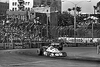 LONG BEACH, CA: Ronnie Peterson drives the Tyrrell P34 5/Ford Cosworth DFV ahead of Clay Regazzoni in the Ensign N177 MN-06/Ford Cosworth during the United States Grand Prix West on April 3, 1977, on the temporary street circuit in Long Beach, California.