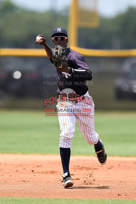 GCL Yankees 1 shortstop Jorge Mateo (11) throws to first during the second game of a doubleheader against the GCL Braves on July 1, 2014 at the Yankees Minor League Complex in Tampa, Florida.  GCL Braves defeated the GCL Yankees 1 by a score of 3-1.  (Mike Janes/Four Seam Images)