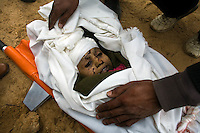 Al Tufa'ah, Gaza Strip, Jan 20 2009.Shourouk Nadji Hessenin, 13 and her brother Abdallah, 12 were killed instantly upon returning to their house in She'Af Tufa'ah by a Hamas planted booby trap destined to israeli soldiers. Hundreds of houses, farms and factories have been destroyed and bulldozed over by the Israeli army, flattening approximately an area 10km square, ruining countless families, left resourceless in what amounts to collective punishment..