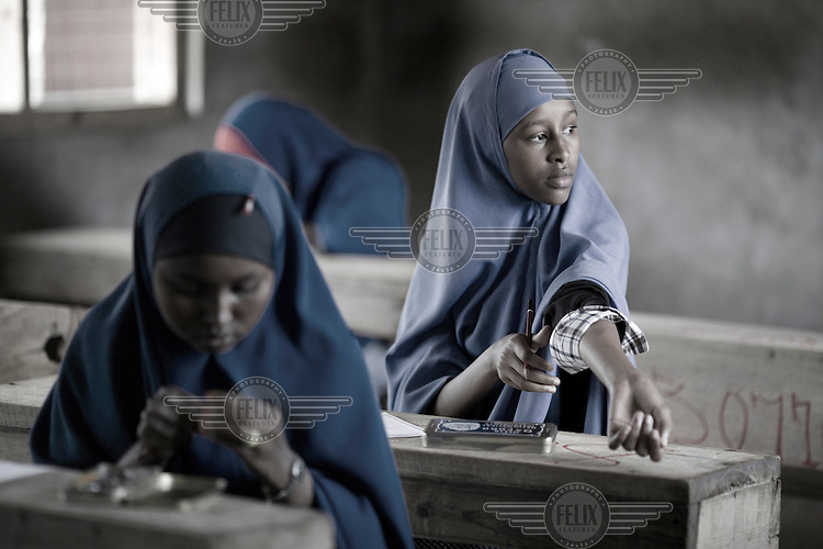Students attend a school in a refugee camp in Dadaab. The 17 year old Dadaab camp complex is one of the oldest, largest and most congested refugee sites in the world. Located in remote northeastern Kenya, near the Somali border, refugee numbers at the camp continue to grow as the situation in Somalia shows little sign of improvement. In 2008, 60,000 Somali refugees crossed into Kenya, leading to severe overcrowding, with the three Dadaab camps now three times their initial capacity. .