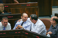 "Minister of Economics Naftali Bennett (L) and Education Minister Shai Piron hug sitting next to and Defense Minister Moshe (""Boogie"") Yaalon (R) and  Israel's Minister of Communications Gilad Erdan during a plenum session voting on the state budget, in the Knesset, Israel's Parliament, in Jerusalem, late night July 29, 2013. The Knesset approved the State Budget at second and third readings in the early hours of Tuesday morning in a 58-43 vote, following a 15-hour parliamentary session. Photo by Oren Nahshon"