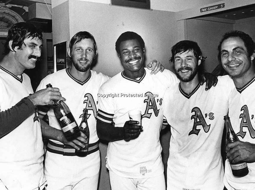 End of a era, Oct 1976, A's players, Rollie Fingers,Joe Rudi, Don Baylor, Gene Tenace, and Sal Bando celebrate with champane all leaving Charlie Finley. (Campy Campaneris) not in photo also was leaving..(copyright 1976 Ron Riesterer)