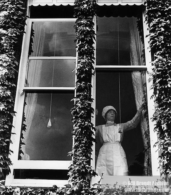 Parlourmaid at window, 1939