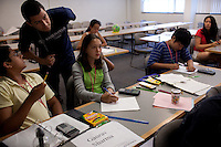 Instructor Rodolfo Nuñez answers a question from Gaurav Sharma, far left, sitting beside Gabrielle Rich, center, during a quiz in Mathematical Modeling class during the Center for Talented Youth summer program at Lafayette College in Easton, PA on July 06, 2012. Several students were part of the Rural Connections scholarship program being offered for the first time this year.