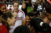 The Wolfpack celebrate thier win over the No. 5 Blue Devils. NC State defeated Duke 75-73 during quarter finals of the 2012 ACC Women's Basketball Tournament at the Greensboro Coliseum in Greensboro, NC. Photo by Al Drago.