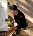 WA02317-00...WASHINGTON - Carpenter working on a house remodel.