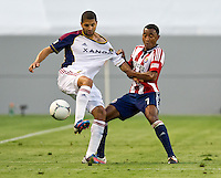 CARSON, CA - June 16, 2012: Real Salt Lake forward Alvaro Saborio (15) and Chivas USA defender James Riley (7) during the Chivas USA vs Real Salt Lake match at the Home Depot Center in Carson, California. Final score Real Salt Lake 3, Chivas USA 0.