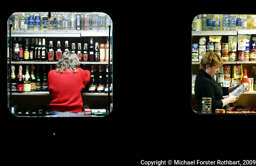 In Sukachi, a small food and liquor store in a converted trailer doubles as the village bar. Nina Dubrovskaya works here, earning more than twice what she did as a village librarian. <br /> ------------------- <br /> This photograph is part the book of Would You Stay?, by Michael Forster Rothbart, published by TED Books in 2013. The photos come from Forster Rothbart&rsquo;s two long-term documentary photography projects, After Chernobyl and After Fukushima.<br /> &copy; Michael Forster Rothbart 2007-2013.<br /> www.afterchernobyl.com<br /> www.mfrphoto.com &bull; 607-267-4893 &bull; 607-436-2856 <br /> 34 Spruce St, Oneonta, NY 13820<br /> 86 Three Mile Pond Rd, Vassalboro, ME 04989<br /> info@mfrphoto.com<br /> Photo by: Michael Forster Rothbart<br /> Date:  11/2008    File#:  Canon 20D digital camera frame 11371 <br /> -------------------