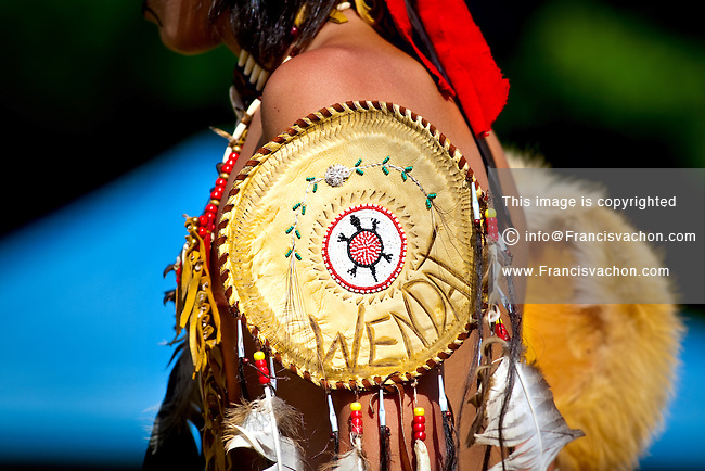 A young natives wearing Huron-Wendat traditional dresses and paint  takes part into the dance contest of the Wendake Pow-Wow July 31, 2010. The Wyandot (also called Huron) are indigenous peoples of North America, known in their native language of the Iroquoian family as the Wendat.