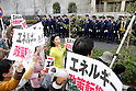 April 10, 2011, Tokyo, Japan - Carrying placards and banners reading Nukes, frustrated Tokyo residents make their feelings clear in anti-nuclear protests in front of the Ministry of Economy, Trade and Industry on Sunday, April 10, 2011. Some 15,000 people took to the streets in Tokyo in two separate protest against Tokyo Electric Power Company, the operator of the crippled nuclear plant in Fukushima, some 200 km northeast of Tokyo. (Photo by AFLO) [3609] -mis-