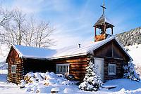 Snow Covered Log Church at Konni Lake, Nemaiah Valley, BC, British Columbia, Canada - Cariboo Chilcotin Coast Region, Winter