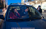 At left, U.S. Senator Mark Begich (D) Alaska begins his election day on a radio talk show via cell phone in downtown Anchorage Tuesday, November 4, 2014.  With Begich are staffers Jackson Spivey and Rachel Barinbaum.  (AP Photo/Michael Dinneen).