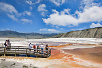 Visitors congregate at a favorite overlook, Mammoth Hot Springs Terraces, Yellowstone National Park.  Yellowstone National Park, the first National Park in the world, still enthrals over three million visitors a year with it's geothermal features,wildlife,  rugged mountains, deep canyons and stunning ecosystem.