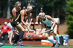 30 August 2014: Iowa's Chandler Ackers (left) and Wake Forest's Jess Newak (3). The Wake Forest University Demon Deacons played the University of Iowa Hawkeyes at Francis E. Henry Stadium in Chapel Hill, North Carolina as part of the ACC/Big 10 Challenge and an 2014 NCAA Division I Field Hockey match. Iowa won the game 4-1.