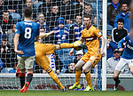 Louis Moult shoots for goal but the ball nicks off the heel of  the offside Stephen Pearson on the way in