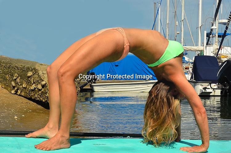 Stock photo Yoga on Paddle board