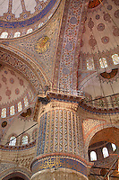 Detail of ornate tiled ceiling and column, Sultan Ahmed Mosque, or Blue Mosque, 1609-16, by Mehmet Aga, Istanbul, Turkey. Built near the Hagia Sophia, the Blue Mosque combines Byzantine style with Islamic architecture. The blue tiles of the interior inspired its popular name, The Blue Mosque. The historical areas of the city were declared a UNESCO World Heritage Site in 1985. Picture by Manuel Cohen.