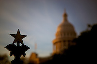 """Austin, Texas State Capitol gate """"Lone Star"""" detail with blurred capitol in the background."""