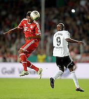 FUSSBALL       DFB POKAL 1. RUNDE        SAISON 2013/2014 BSV Schwarz-Weiss Rehden  - FC Bayern Muenchen  05.08.2013 Jerome Boateng (li, FC Bayern Muenchen) gegen Kifuta Kiala Makangu (re, Rehden)