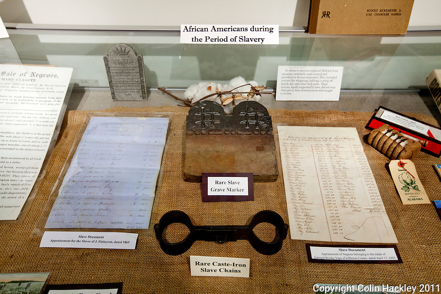 SHACKLED AND SOLD: Slave shackles and other documents classifying humans as property are part of the Slavery in the Old South collection at The Black Archives in Tallahassee..COLIN HACKLEY PHOTO