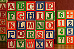 Alphabet Blocks stacked together with numbered blocks