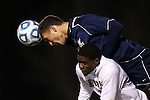 24 November 2013: Navy's Derek Vogel (above) fouls Wake Forest's Sean Okoli (below) while challenging for a header. The Wake Forest University Demon Deacons played the Naval Academy Midshipmen at Spry Stadium in Winston-Salem, NC in a 2013 NCAA Division I Men's Soccer Tournament Second Round match. Wake Forest won the game 2-1.