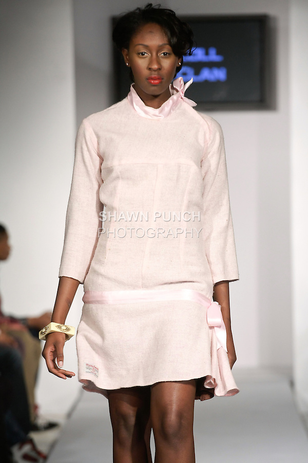 Model walks runway in an outfit from the Mccoll & Clan Fall 2012 collection by Lusmila Mccoll, during BK Fashion Weekend Fall Winter 2012.